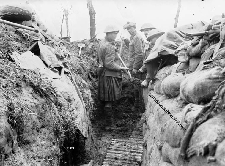 Canadian Expeditionary Force 13th Inf., Battalion R.H.C. Occupying recently captured German trench, July, 1916.