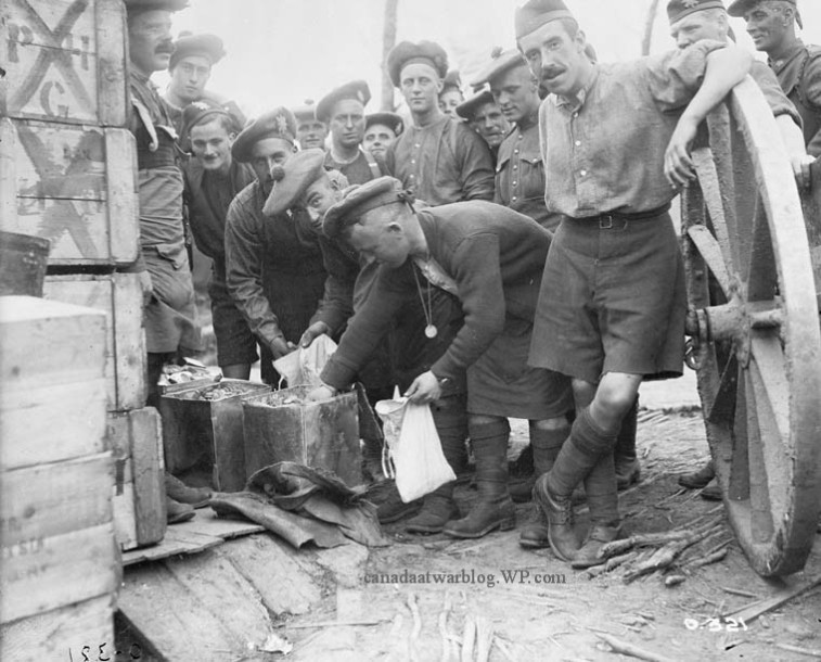 Canadian Expeditionary Force 13th Infantry Battalion Royal Highlanders of Canada drawing rations, July, 1916.
